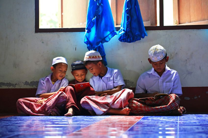 A small group of Muslim boys attend religious school session to read Koran in a local mosque in Thailand's Deep South.